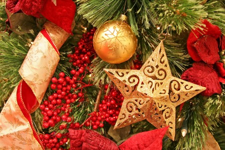 Christmas tree decorations with focus point on the golden star Stock Photo - 3980346