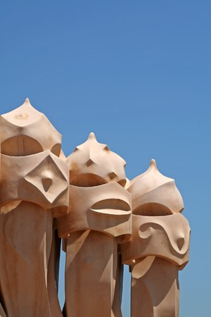 casa: Abstract sculptures by Gaudi (built 1906-10), on the rooftop of Casa Mila house at Barcelona, Spain.