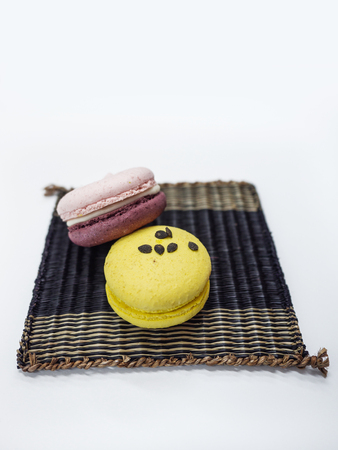 Colorful macarons on the wooden mat