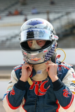 5-14-2012 Marco Andretti at Indianapolis Motor Speedway putting on helmet Editorial