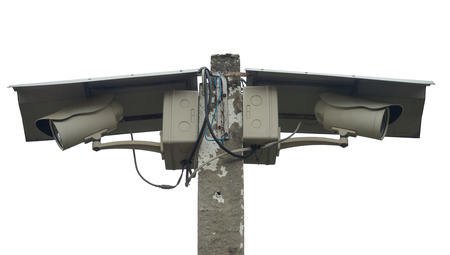 closed circuit: Two Closed Circuit Televisions (CCTV)  Cameras mounted on a concrete pole with covered shields (isolated). Stock Photo