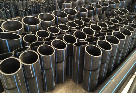 HDPE pipes waiting for examining in the industry factory, cutting pipe for inspecting with high quality control. Stock Photo