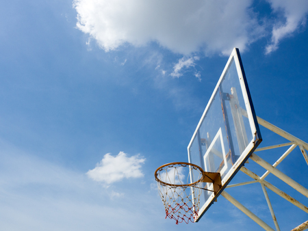 backboard: Old basketball hoop with backboard against  blue sky, white cloud