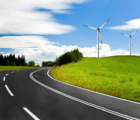 country highway: Country highway and wind turbines Stock Photo