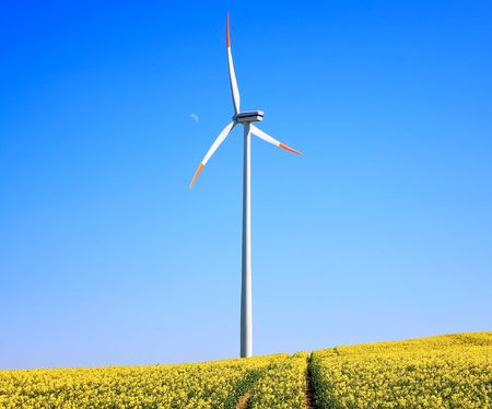 Wind turbine on blue sky  Stock Photo - 6067964
