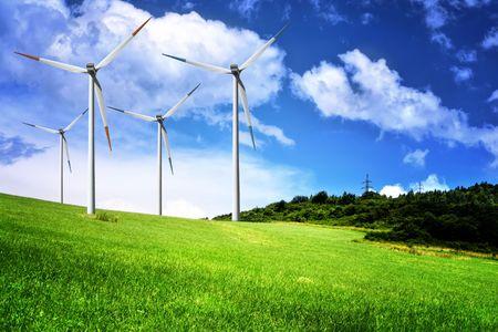 Wind farm on green field photo