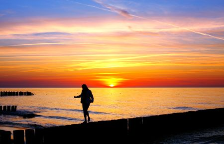 Woman silhouette in the sunset Stock Photo - 6666653