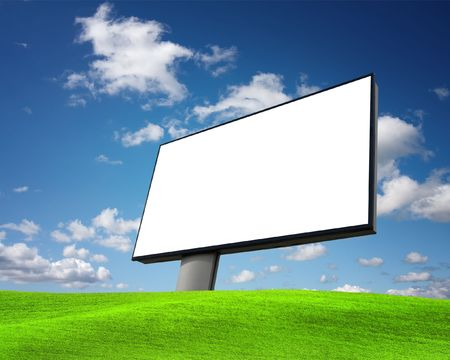 Empty billboard on green field photo