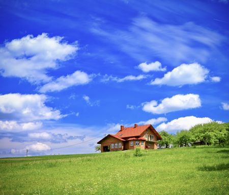New house on cloudy sky Stock Photo
