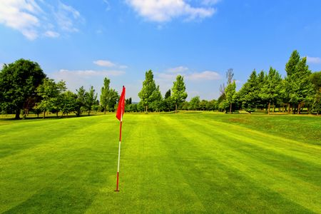 Beautiful golf course and blue sky photo
