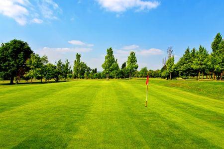 golfcourse: Golf course and blue sky