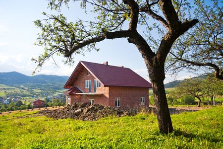 Apple tree and new house Stock Photo - 7650161