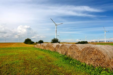 Straw bales and wind turbines photo