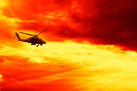 blackhawk helicopter: Military helicopter on Sunset Stock Photo