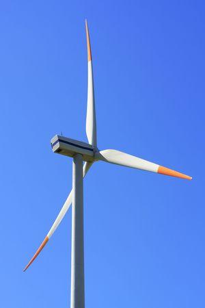 Wind turbine on blue sky photo