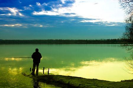 fishing lake: Fishing in a lake  Stock Photo