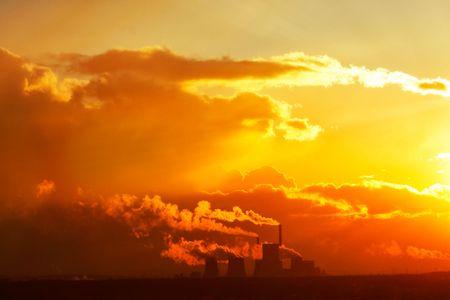Smoke factory sunset photo