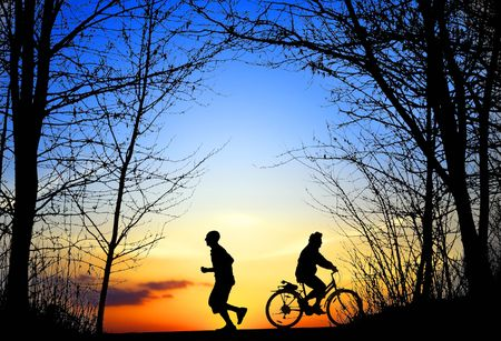 Recreation, jogging and cycling at sunset photo