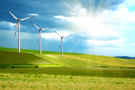Wind turbines farm on green island Stock Photo