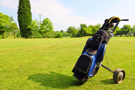 golf equipment: Golf equipment on green field Stock Photo