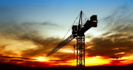 cranes: The construction crane on sunset