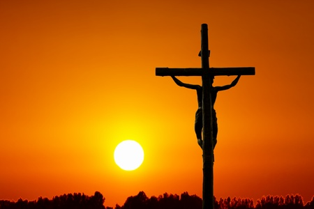 forgive: Holy cross at sunset