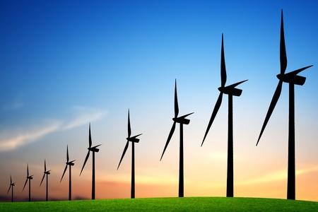 Wind turbines bij zons ondergang Stockfoto