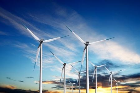 turbina: Molinos de viento al atardecer Foto de archivo