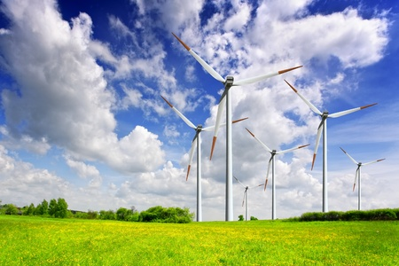 Wind turbines on spring field photo