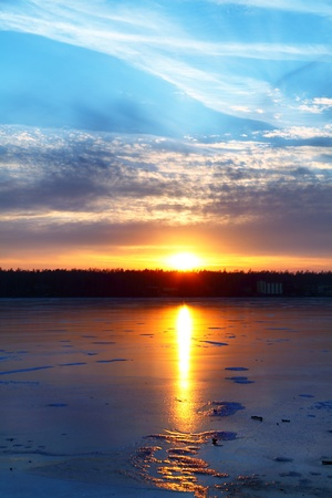 Sunset in the winter lake photo