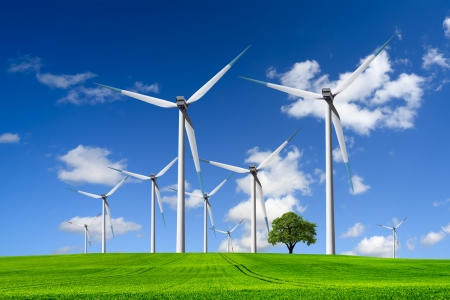 wind mill: Wind turbines farm on green field