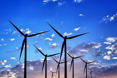 Wind turbines at sunset photo