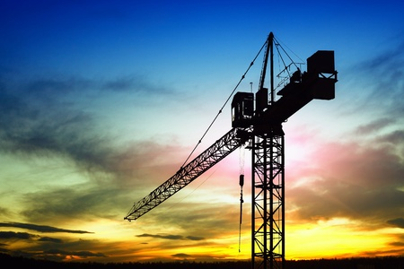 tower crane: Construction site at sunset Stock Photo