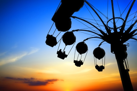 rollercoaster: Amusement park at sunset Stock Photo
