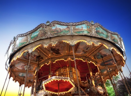 Vintage carousel at sunset in Paris photo