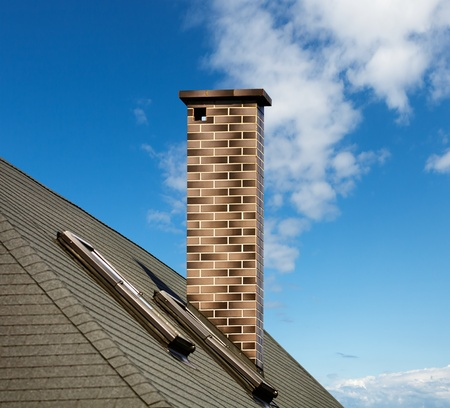 smoke stack: Mosaic chimney on the roof Stock Photo