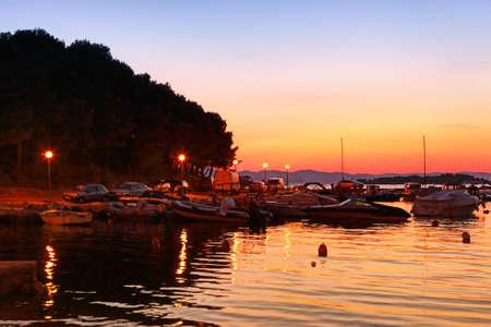 moorings: Sailing boats in marina at sunset