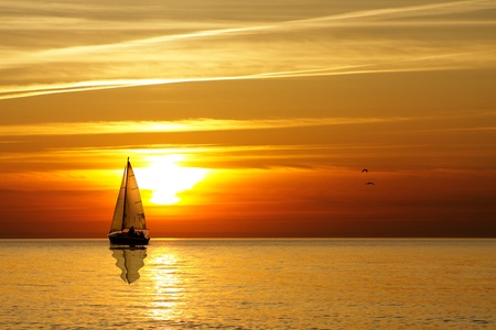 Sailing at sunset photo