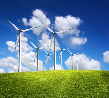 energy production: Windmills in summer landscape Stock Photo