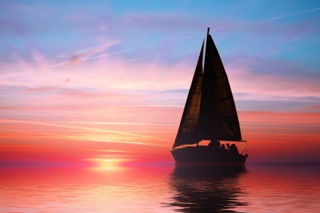 yellow boats: Sailing at sunset on the ocean