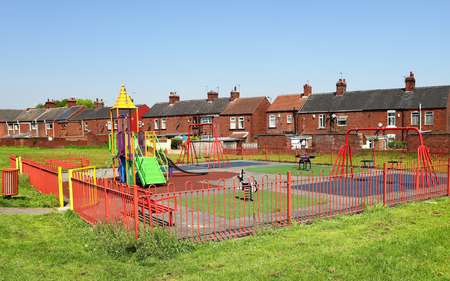 Playground and typical English buildings photo