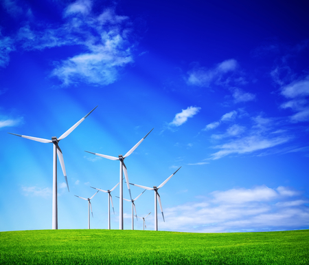 wind energy: Green meadow with wind turbines Stock Photo