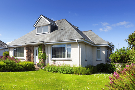 Traditional english detached house with garden Stock Photo