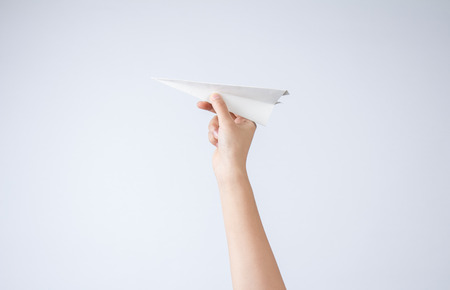 Handheld paper aircraft Imagens