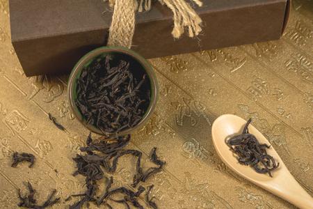 Tea cup and tea leaves