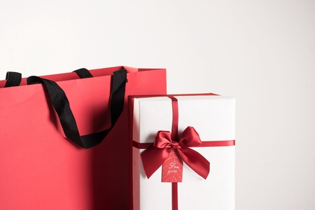 Gift boxes and shopping bags on white background