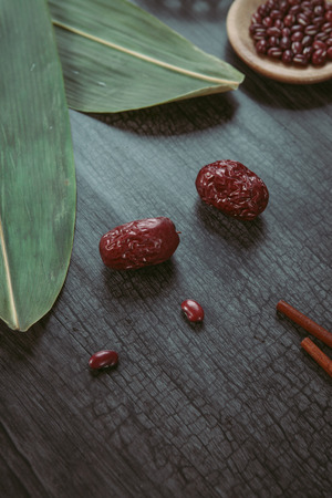 Red dates on wooden table