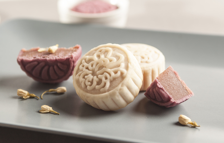Moon cake on grey background