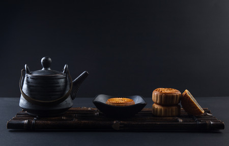 Moon cake and tea set on the table