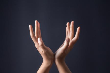 Hand gesture on dark background